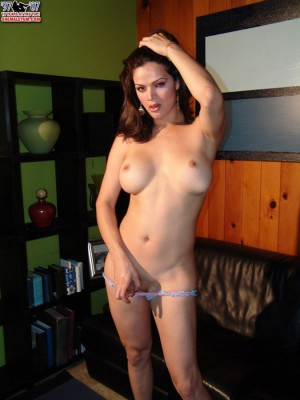 Fully bald buxomy brunette hair tranny nurse disrobes