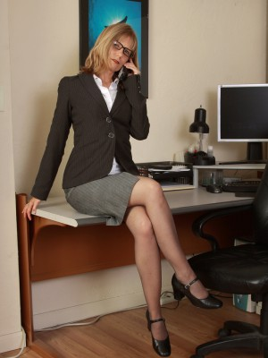 Insatiable golden-haired secretary Lexa Mayfair pulls open her box on the desk