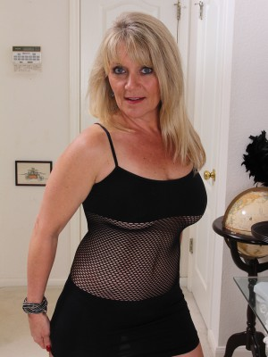 Insane blond 48 year old Sherri Donovan in fishnet underwear posing