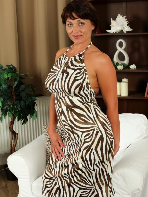 Curvaceous 38 year old Belle P glides out of her elegant dress to spread