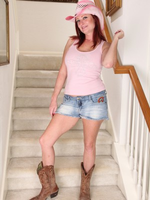 Redheaded Mummy Shelly Jones disrobes off her jeans cut-offs on the stairs