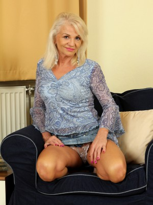 47 year older Inez shows off her gorgeous aged body inwards the livingroom