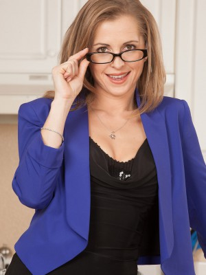 Golden-haired MILF Melissa Rose takes off her glasses plus dresses here