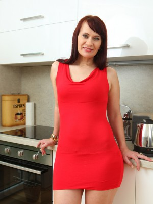 Crazy long haired Vera Sheer pleasure stretches her gams found on the kitchen counter