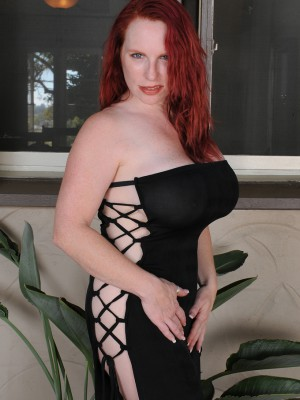 Red Vixen from AllOver30 undresses off her black colored elegant gown outdoors