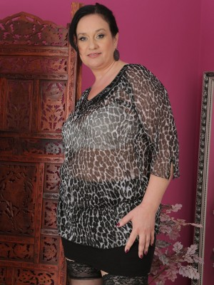 Elegant 48 yr old Ria Darksome unclothes and poses along with her gams open