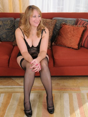 Lounging in thigh high ebony tights with stunning Catrina Costa