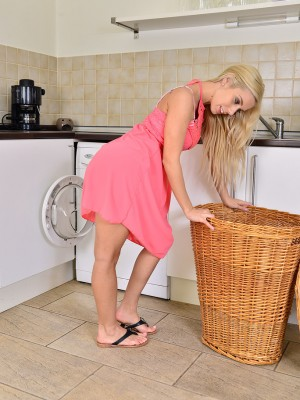 Stunning blond Nesty does some washing and flashes the lady perfect form