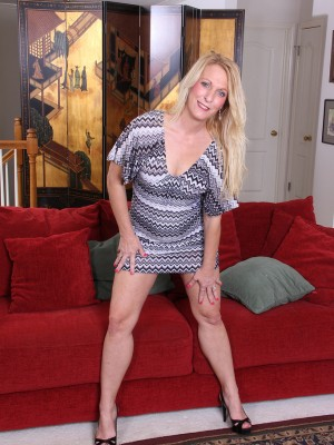 Golden-haired sexpot Jackie will soon be removing the lady gown and heels to bang herself with a toy