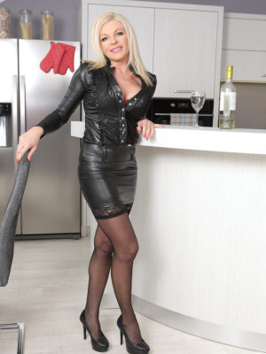 Golden-haired MILF Carolina Carla likes one cup of wine before gliding out of the doll tight leather