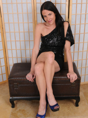 Passionate raven haired Maggie K has a stylish fast black colored dress as well as hotter blue your back heel footwear on