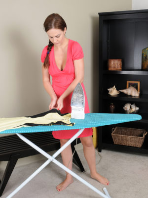 Beautiful breasty Tina Kay does some ironing and shows your ex perfect normal orbs