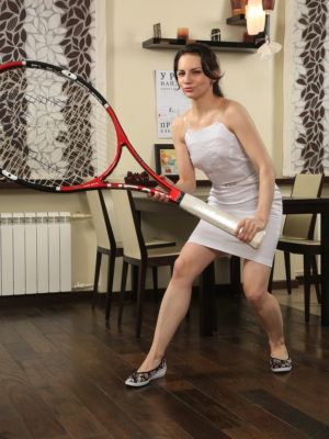 Wonderful Candice performs with her biggest tennis racket