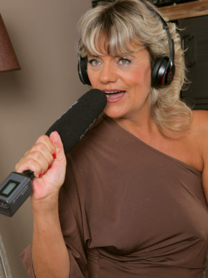 Golden-haired MILF Sherry D is regarding the microphone