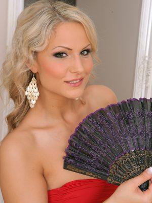 Blond Holly B alongside her fan