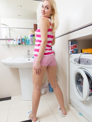 Hairy babe Felicia receives bored while doing laundry
