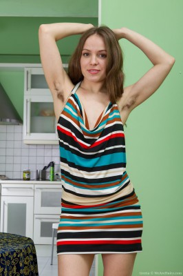 Gretta's curly body as well as the striped dress