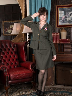 Kate Anne disrobes from her military uniform