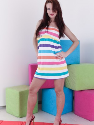 Promesita unwraps from her striped dress to play