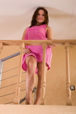 Leona comes downstairs and gets undressed on stairs