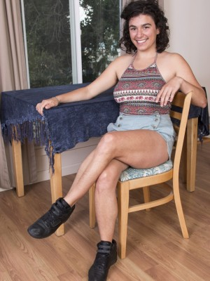 Serai little-by-little peels off on chair displaying hairy human body