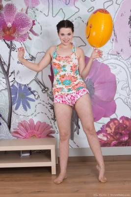 Ella Martin plays with balloon and undresses nude