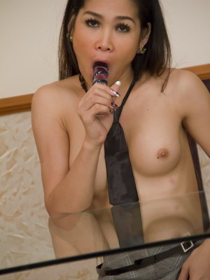office-asian-ladyboy-toys-her-ass-while-shes-at-work-14