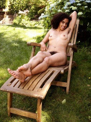 All natural babe Elise posing outdoors in the lounge chair looking sexy