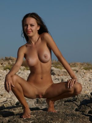 Slender babe nude from the shore