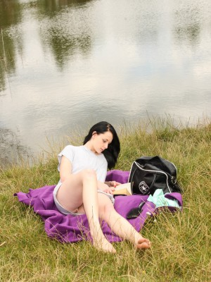 Cute brunette hair Simone fondles her hot wet wet crack by the lake