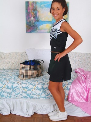 Pointy cheerleader Isabella undresses down to her white socks.