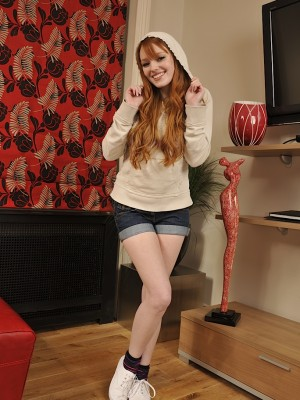 Redhead legal age teenager Kloe Kane undresses down to her birthday suit.