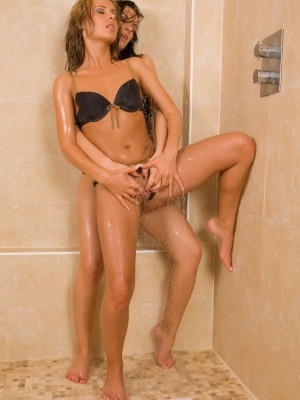 2-sexy-babes-taking-a-shower-together-16