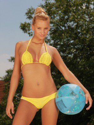Horny golden-haired teen frigging her bawdy cleft by the pool