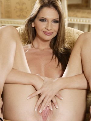pretty-young-brunette-fingers-her-sweet-shaved-pussy-on-couch-15