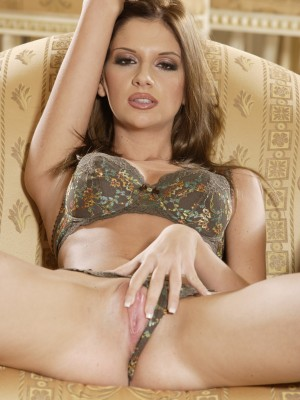 pretty-young-brunette-fingers-her-sweet-shaved-pussy-on-couch-3