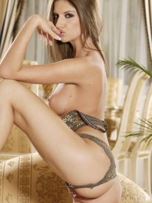 pretty-young-brunette-fingers-her-sweet-shaved-pussy-on-couch-7