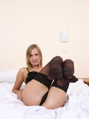 blonde-amateur-polina-masturbates-wearing-only-stockings-4