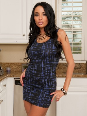 Huge-boobed babe Anissa Kate opens up her pussy in the kitchen.