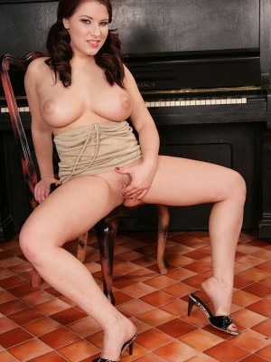 busty-babe-teri-strips-and-shows-off-her-huge-jugs-12