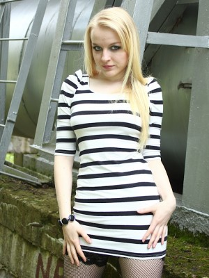 Hawt golden-haired babe Bella Lei unwrapping undressed outdoors.