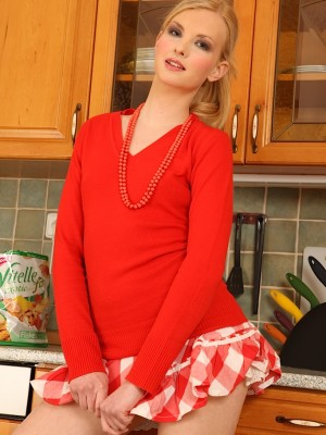 Stunning golden-haired honey Aby Electra undresses nude in the kitchen.