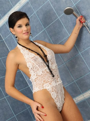 Tall stunner Niky Doll having fun alone in the shower.